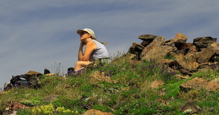 Female hiker resting on rocks