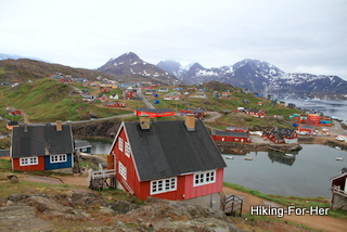 East Greenland village of colorful houses around a bay