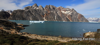 East Greenland bay with towering mountains