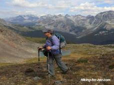 Female hiker with backpack and trekking poles in Canadian Rockies