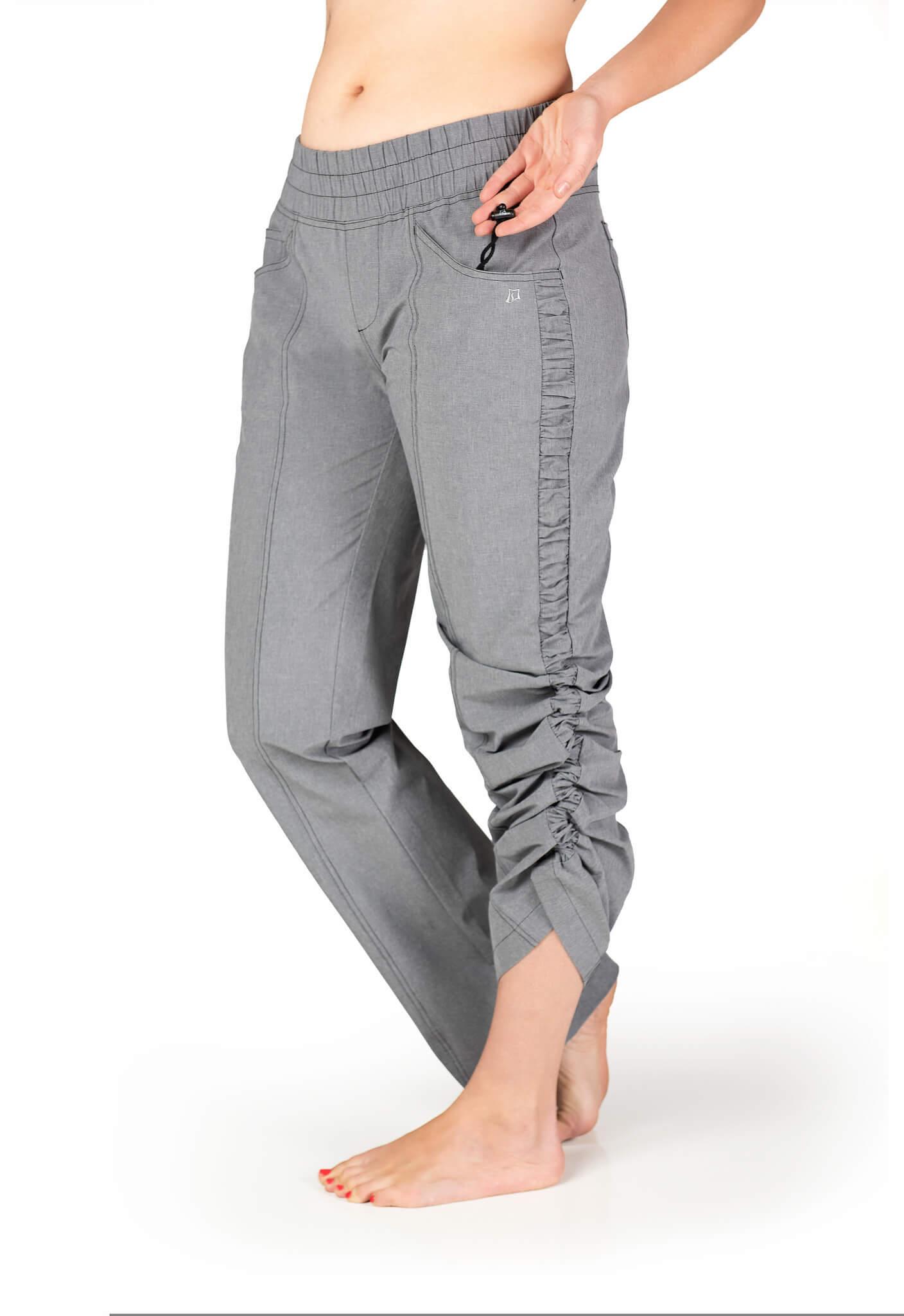 Female hiker wearing gray SkirtSports pants