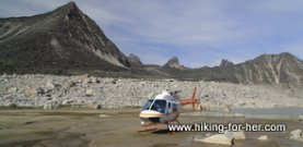 Helicopter on river bed in mountains