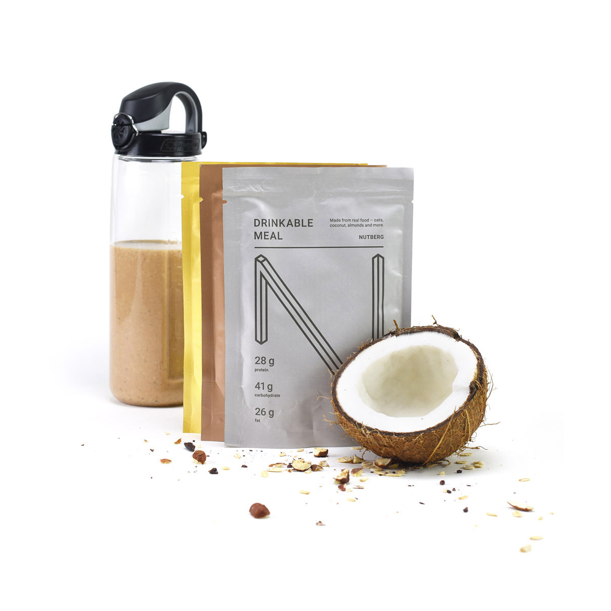 Nutberg drinkable meal with a water bottle and coconut beside the packet