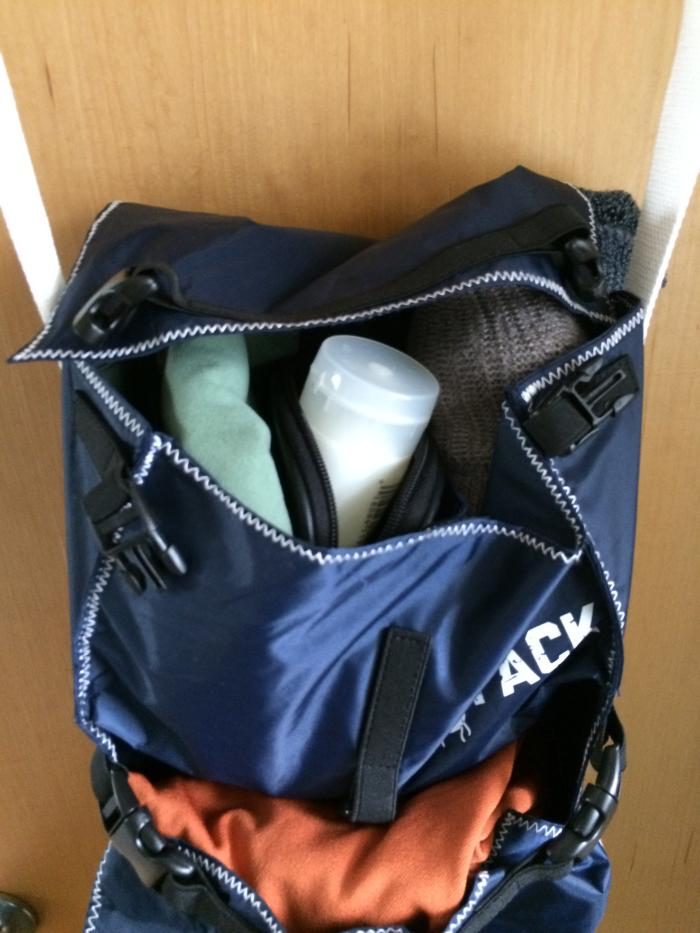Backpack organizer pockets holding personal hygiene items