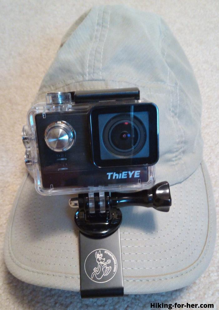 Action camera clipped to a hiking hat