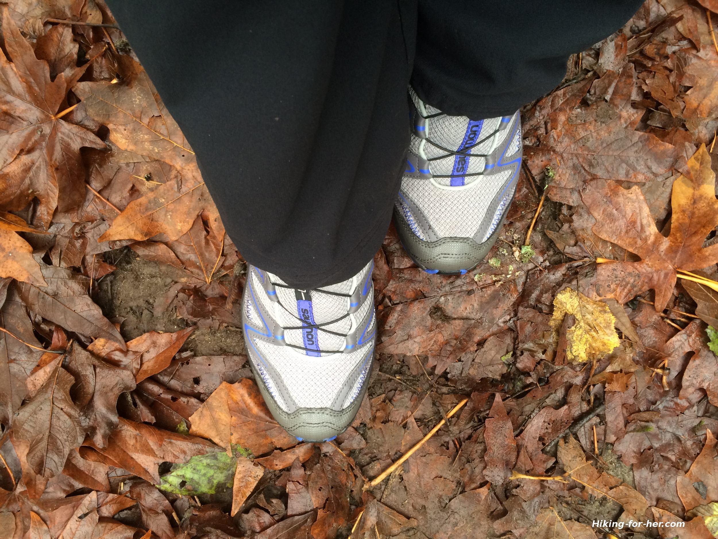A hiker's trail shoes in autumn leaves