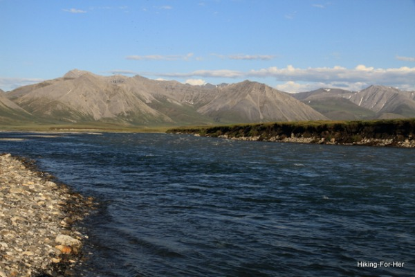The deep blue waters of the Canning River with unnamed mountains in the distance, ANWR, Alaska USA