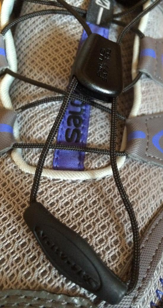 Close up of lacing system on Salomon trail shoe