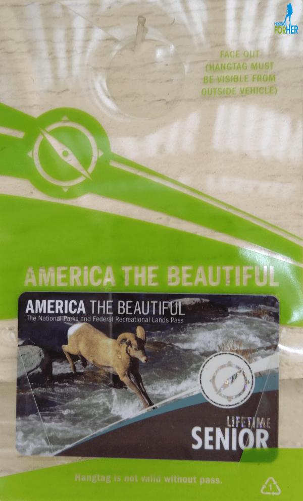 America The Beautiful National Park Pass for seniors with hang tag