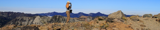 woman photographer surrounded by mountains