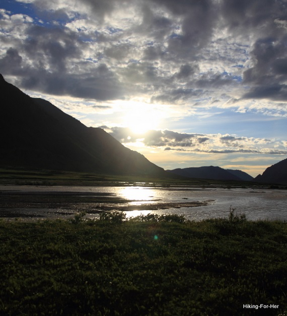 Midnight sun reflecting on Canning River in ANWR Alaska