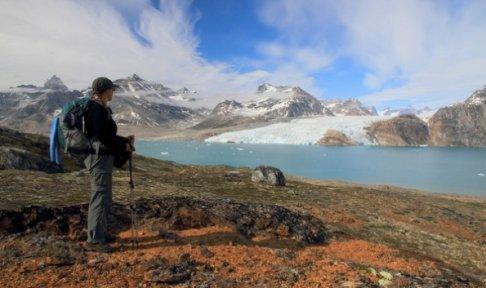 Female hiker gazing at East Greenland glaciers