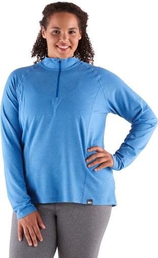 Female hiker in blue long sleeve zip top