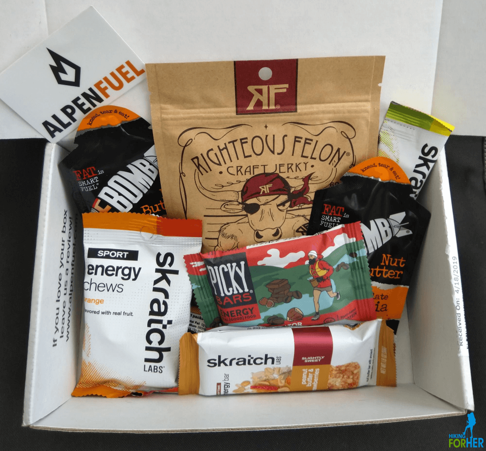 Alpenfuel subscription box of hiking snacks, including trail bars, energy chews, jerky and nut butter
