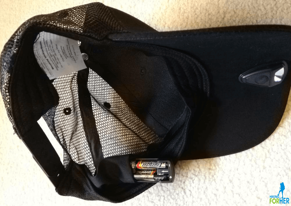 Black cotton and mesh ball cap Powercap showing battery pack in seam