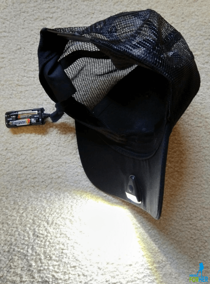 Black ball cap style Powercap showing battery pack in seam and LED light source in brim of hat
