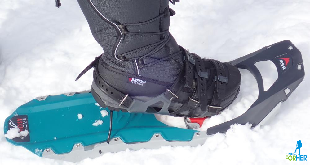 closeup of winter hiking boot attached to snowshoe