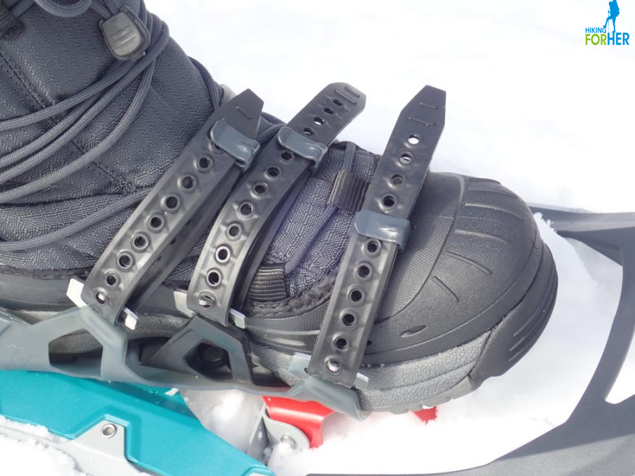 Closeup of winter boot inside snowshoe attachment straps