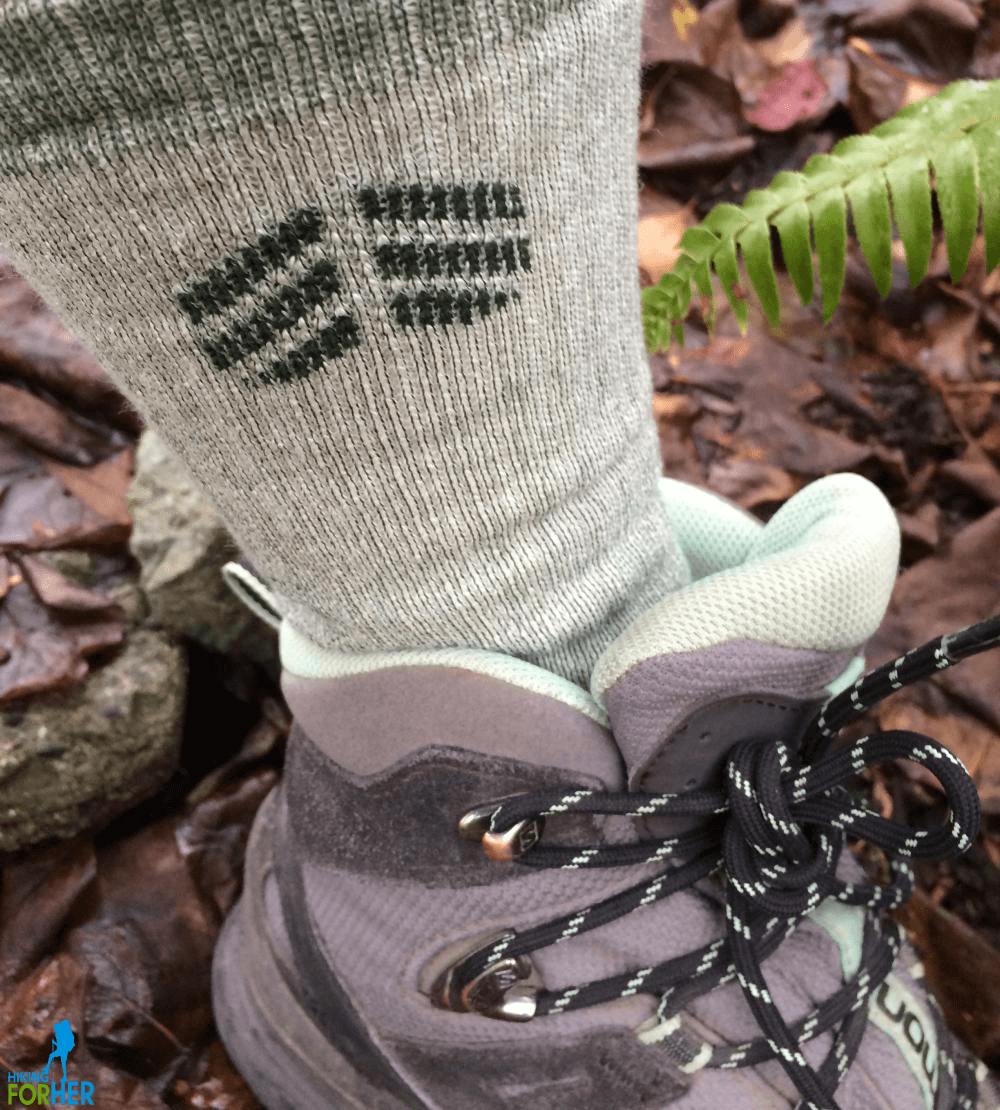 Hiker's foot in crew length hiking sock and hiking boot