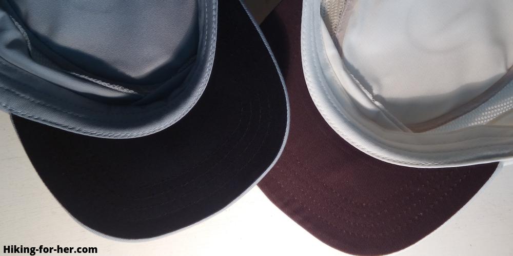 Anti-glare dark colored underside of two hiking hats