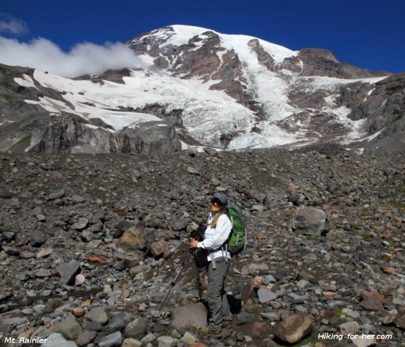 Female hiker on boulders with Mt. Rainier in background