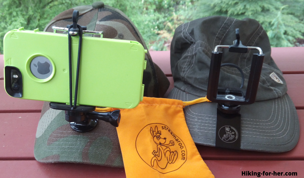 Green hiking hat and green smartphone case with phone mount attached to both