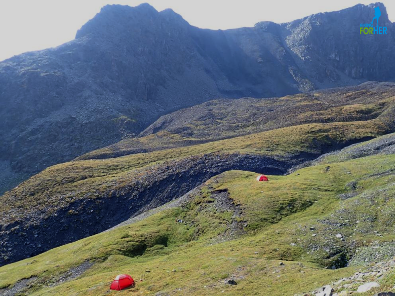 Two red Hilleberg tents at 6700 feet elevation in the Mackenzie Mountains, NWT