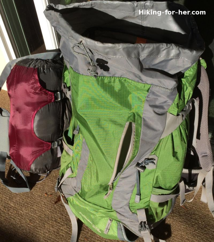 Gobi Gear Hobo Roll leaning against green backpack for size comparison, as reviewed by Hiking For Her