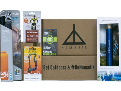 The Nomadik subscription box with examples of hiking gear contained within