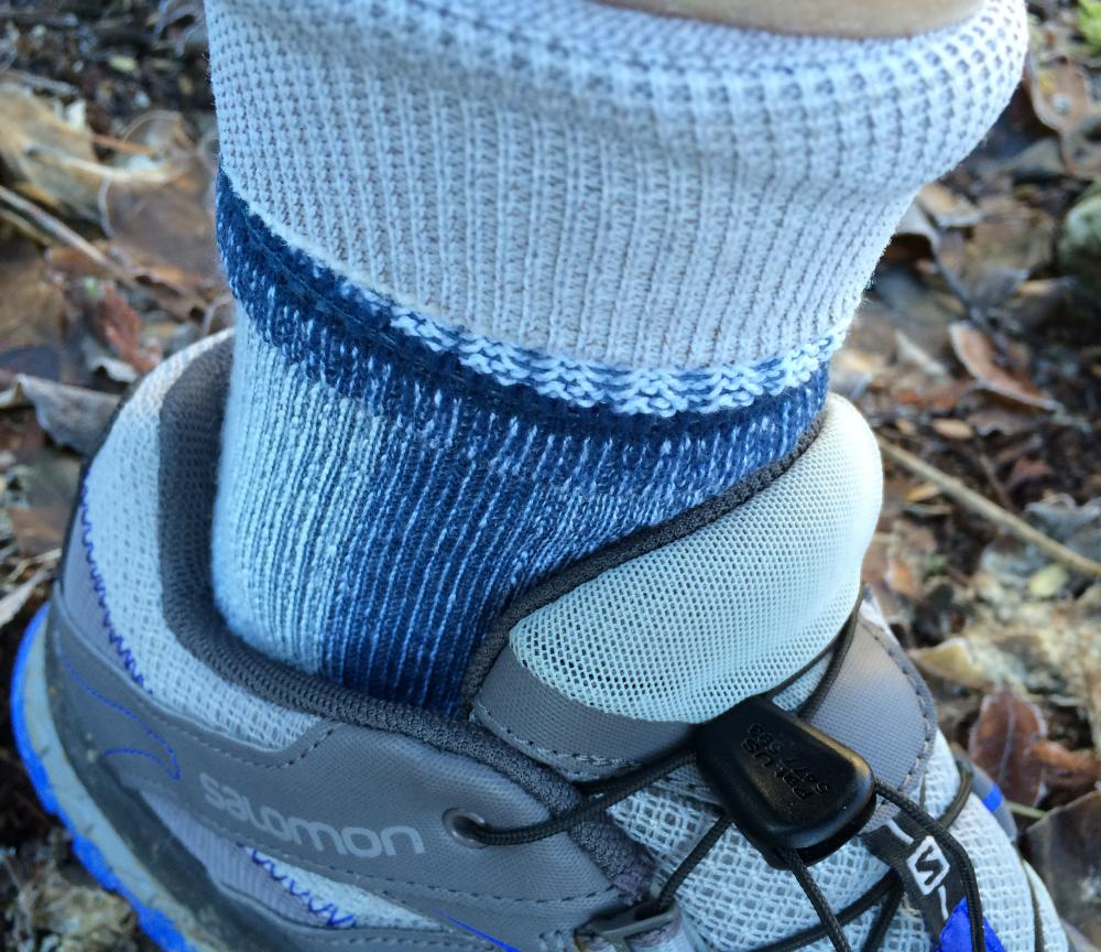 Turned down hiking sock inside a trail shoe