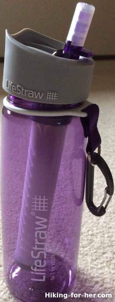 Purple Lifestraw Go filtration bottle with gray top and caribiner on handle