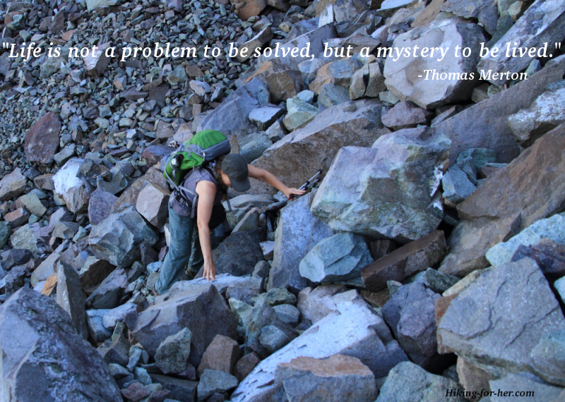 Healthy hiking happens at any age, as this older hiker navigating a boulder field demonstrates.