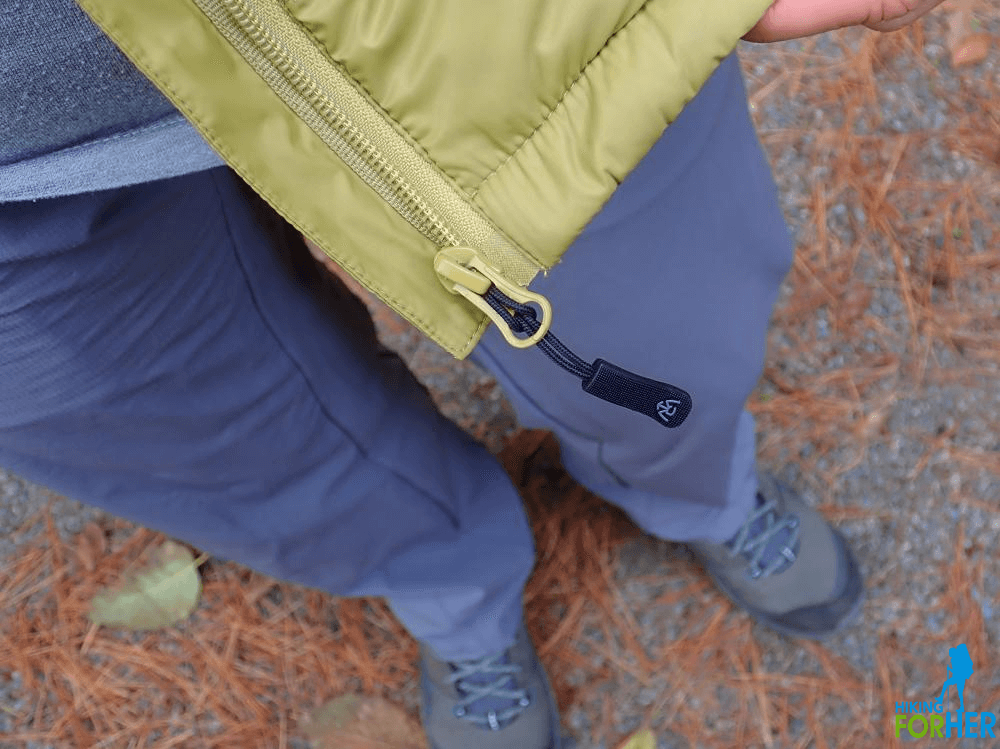 Close up view of a down hiking vest's zipper and stitching