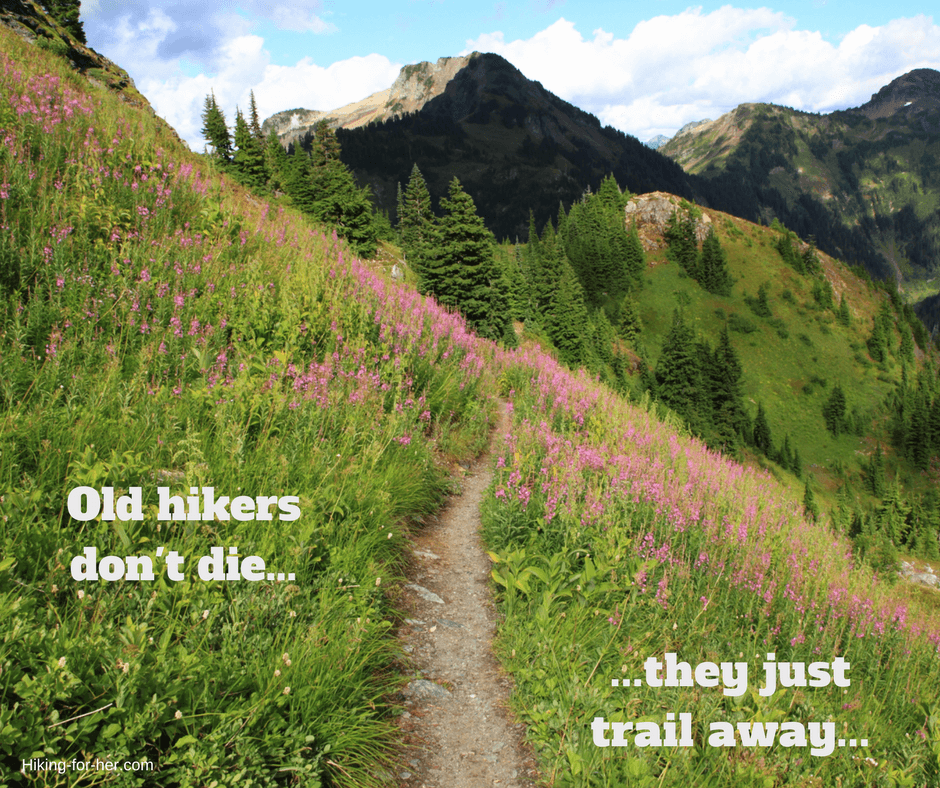 Hiking For Her quote: Old hikers don't die, they just trail away with a hiking trail and blooming wildflowers in background