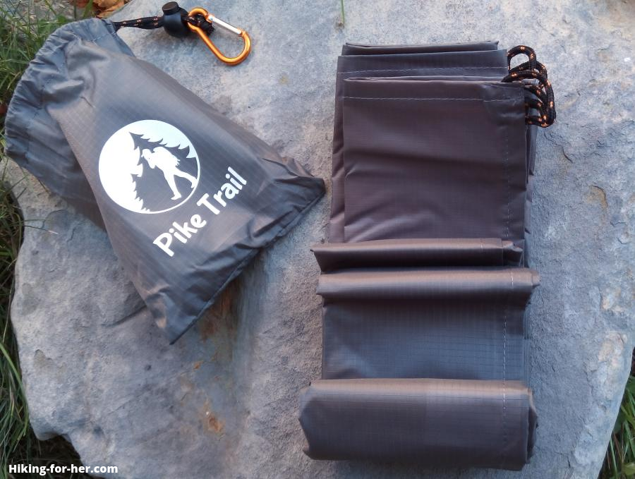 Pike Trail carrying bag and rolled up blanket on a gray rock