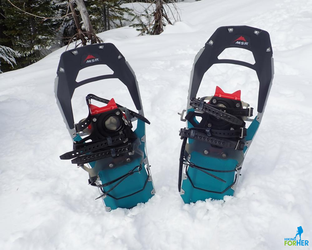 Women's MSR Revo Ascent snowshoes in a snowbank
