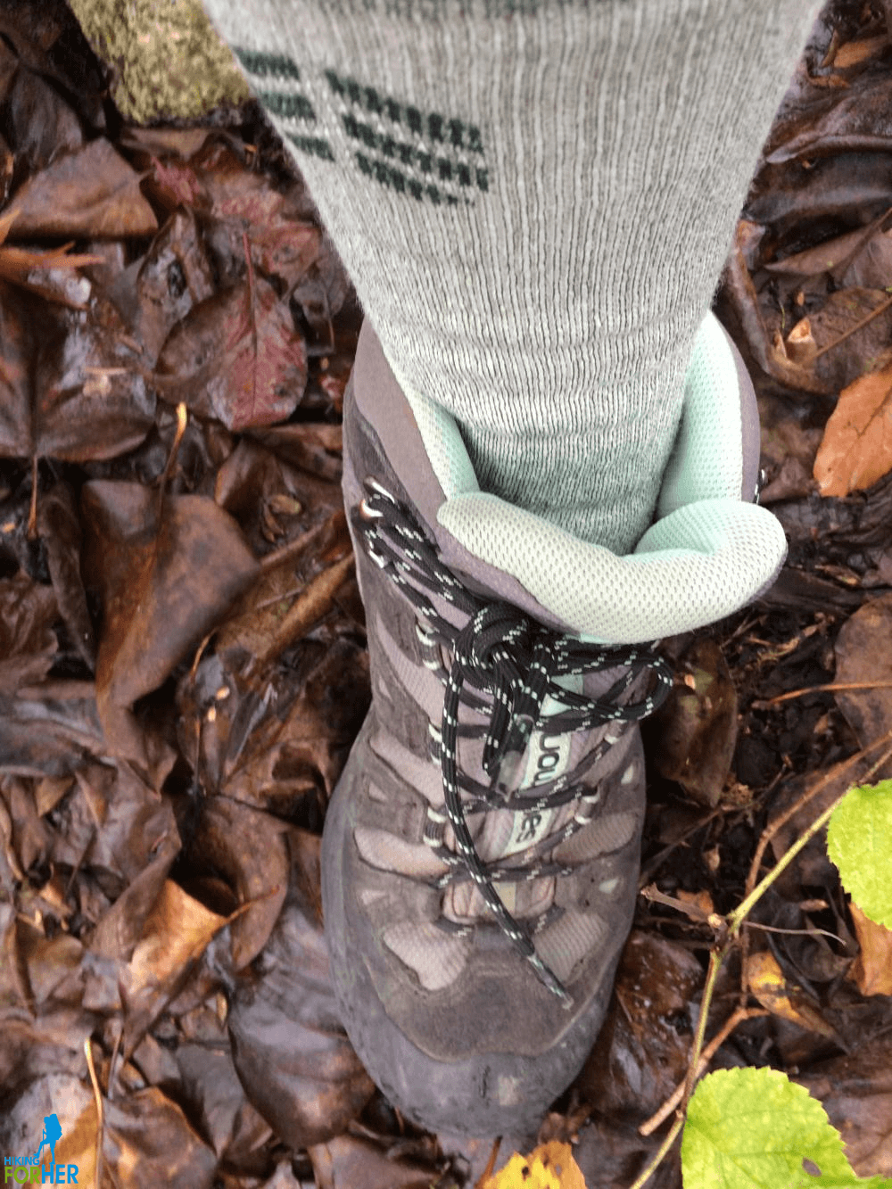 Hiker's calf and shin encased in hiking sock and hiking boot