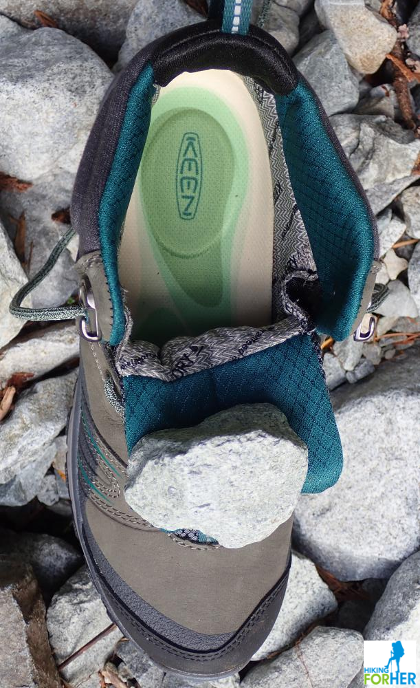 Inside view of a KEEN hiking boot against gray rocks