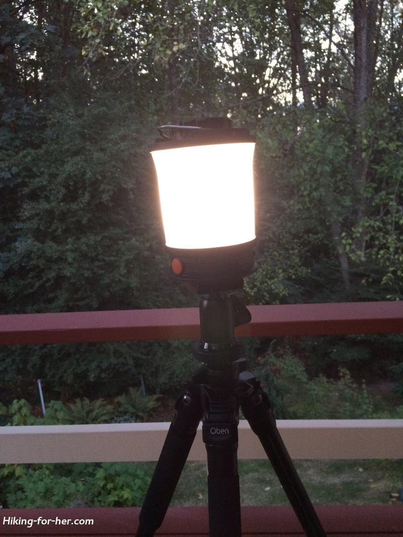 Glowing camp lantern on tripod