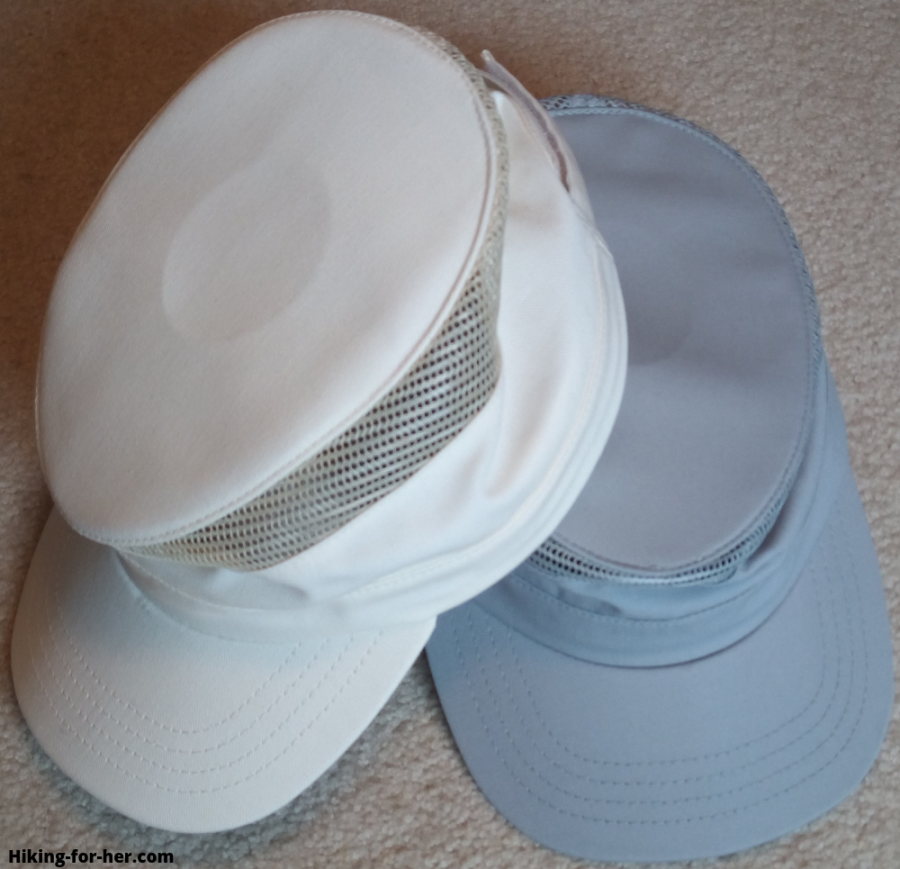 Two lightweight hiking hats, white and gray