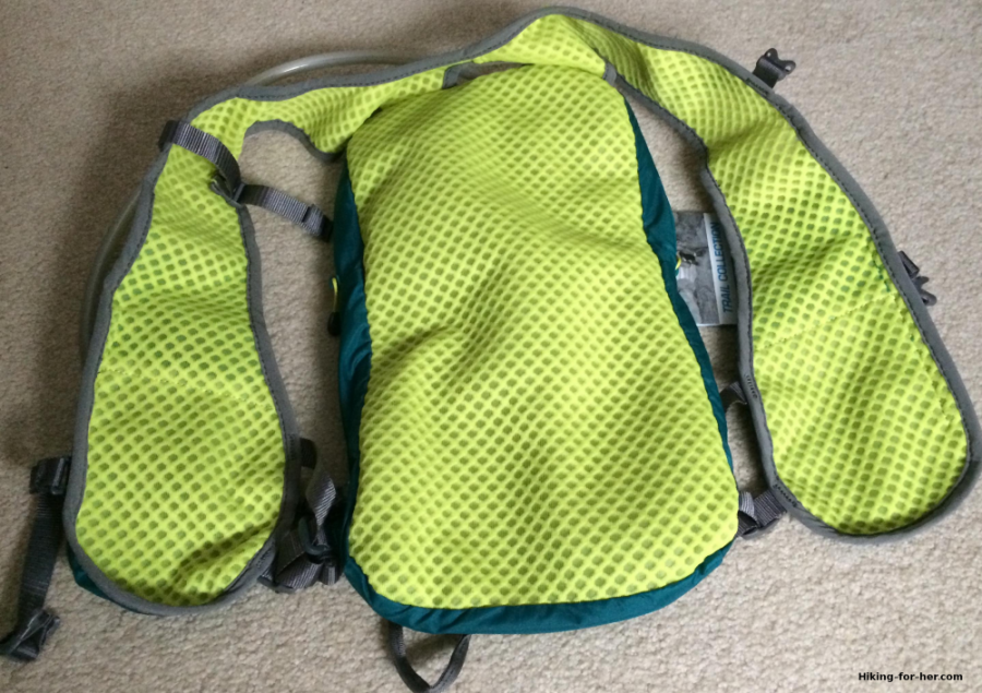 Ultimate Directions hydration vest opened up to reveal mesh lining