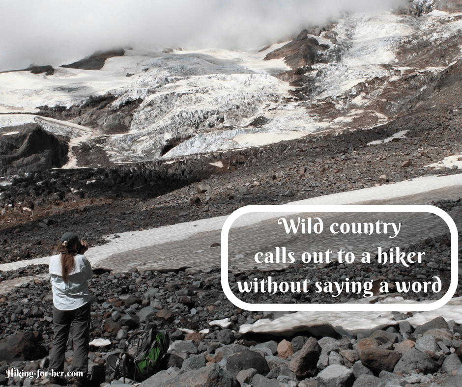 Woman hiker photographing glacier at Mount Rainier