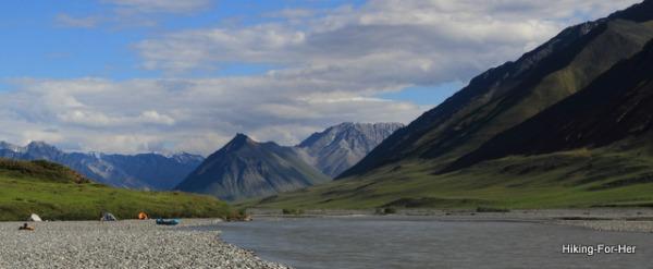 Tents and a blue raft on a gravel bar, Canning River, ANWR Alaska, USA