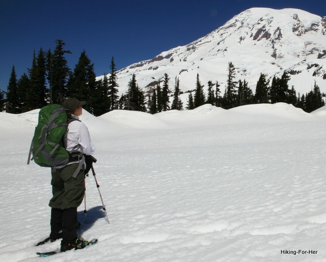 Female snowshoer gazing at Mount Rainier