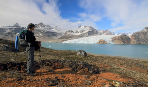 Female hiker gazing at East Greenland glaciers