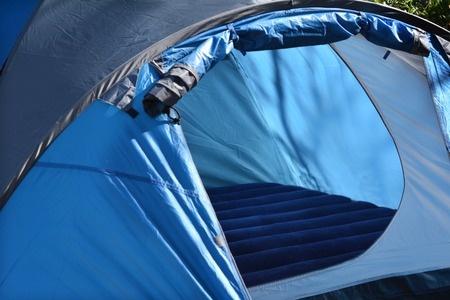 Open door of blue tent showing interior floor