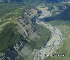 Aerial view of deep river basin (Liard River) and towering cliffs near Fort Simpson, CA