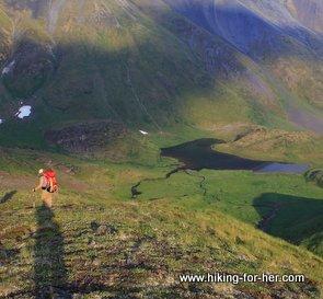 Female hiker on green hills