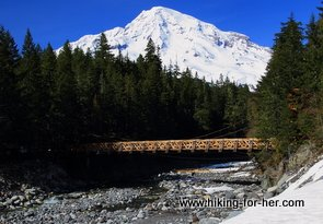 Mt. Rainier in background of wooden bridge