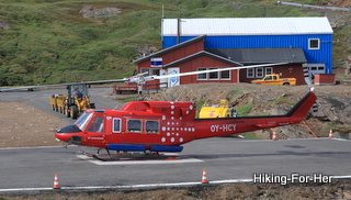 Bright red helicopter to transport hikers to East Greenland from Iceland